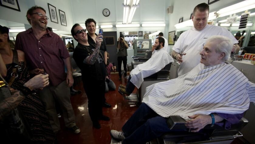 LOS ANGELES, CA JULY 13, 2013: Writer Harlan Elison has his hair cut at Sweeny Todd's Barber Shop by