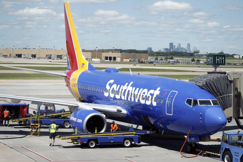A Southwest Airlines passenger is facing federal assault charges after playing footsie with a fellow flier and causing an emergency landing.