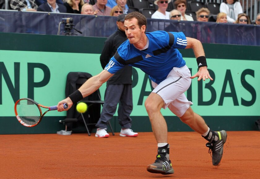 Great Britain's Andy Murray returns a shot against American Donald Young.