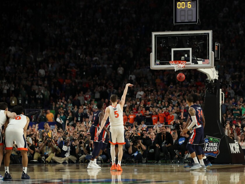 Virginia's Kyle Guy makes the final of three free throws after being fouled on a 3-point basket attempt late in the second half against Auburn on Saturday.