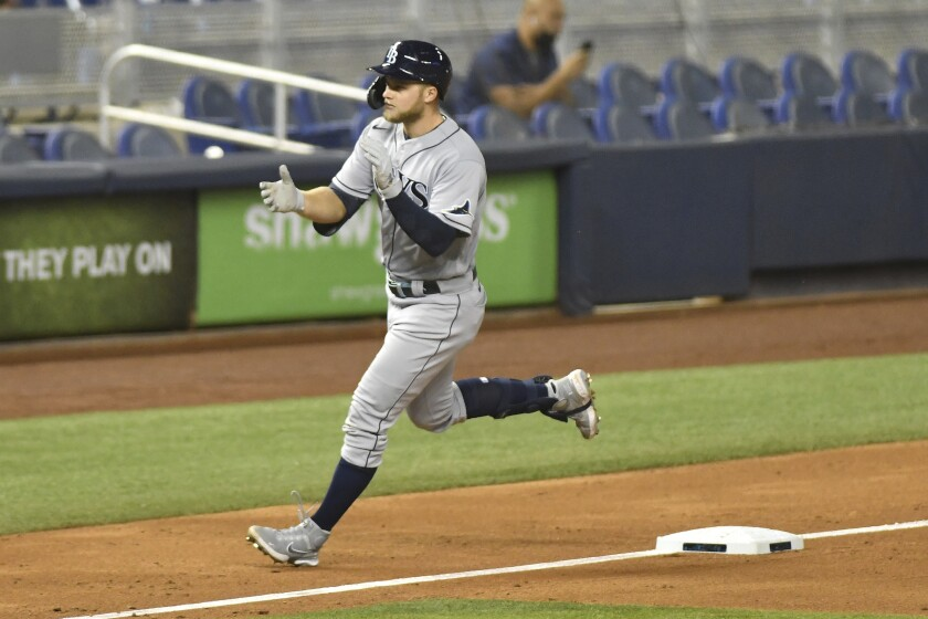 Tampa Bay Rays' Austin Meadows rounds third after hitting home run in the seventh inning of a baseball game against the Miami Marlins, Friday, April 2, 2021, in Miami. (AP Photo/Gaston De Cardenas)
