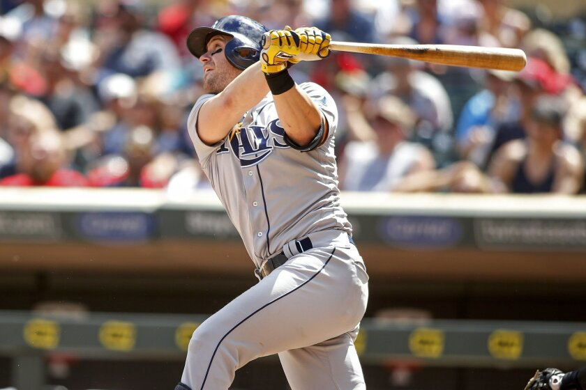 Tampa Bay Rays third baseman Evan Longoria hits his first home run against the Minnesota Twins in the sixth inning of a baseball game, Sunday, June 5, 2016, in Minneapolis. Longoria homered for the fourth consecutive game, connecting twice, and the Tampa Bay Rays earned a 7-5 win against the Minnes