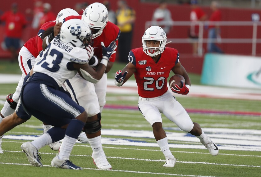 Fresno State running back Ronnie Rivers heads downfield against Utah State during a game earlier this season.