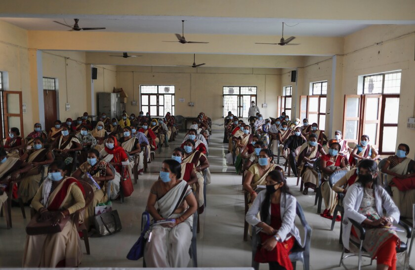 Health workers attend a training session on handling the coronavirus pandemic in villages in Fatehpur, Uttar Pradesh state, India, Wednesday, June 3, 2020. (AP Photo/Rajesh Kumar Singh)