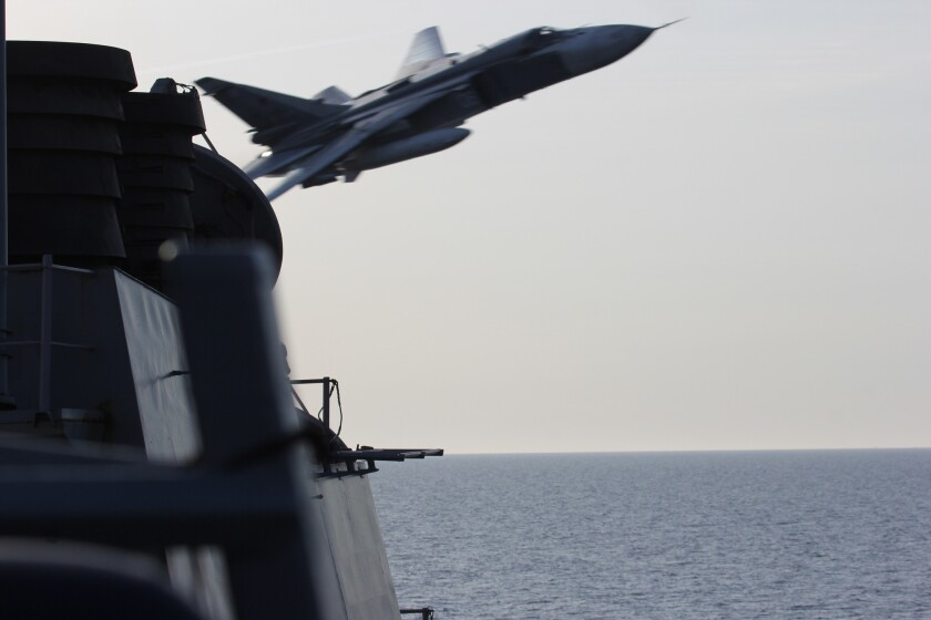 A Russian Sukhoi Su-24 attack aircraft makes a low-altitude pass by guided-missile destroyer Donald Cook on April 12, 2016.
