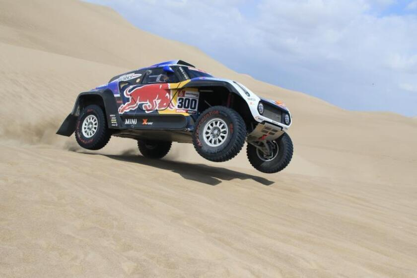 Spanish driver Carlos Sainz, with Mini and the current Dakar Rally defending champion in autos, during the first stage of the 2019 Rally between Lima and Pisco, Peru, on Jan. 7, 2019. EFE-EPA/ Sebastian Castaneda