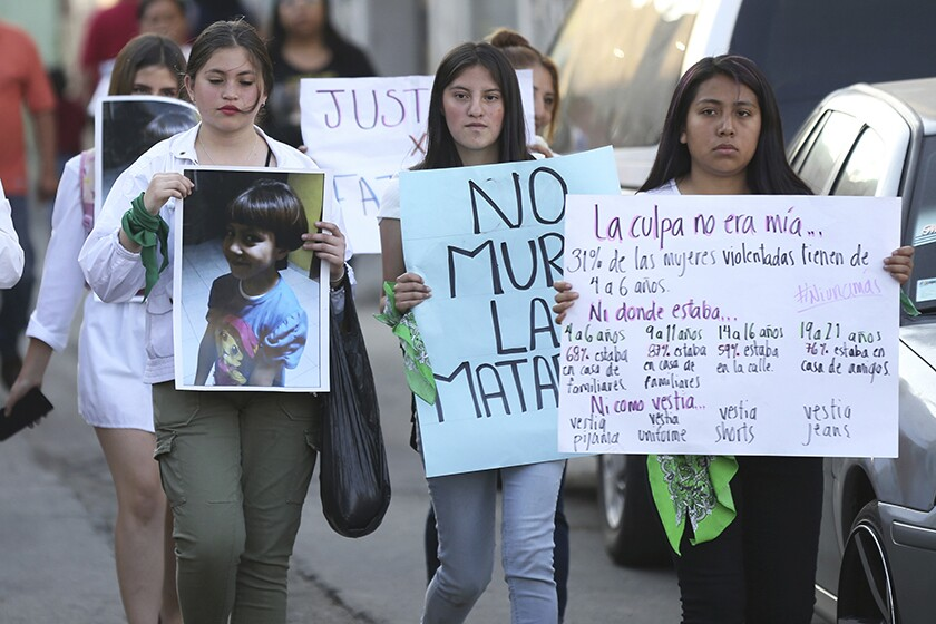 A photo of 7-year-old Fatima is displayed during a march Feb. 17 in Mexico City to protest her murder.