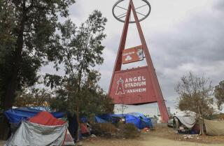 Homeless entrenched in booming tent city along Santa Ana River