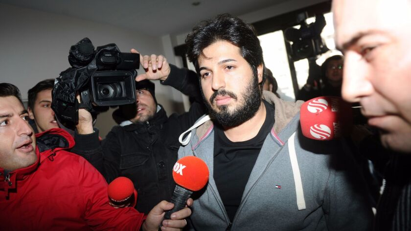 Turkish Iranian gold mogul Reza Zarrab arrives at a police center in Istanbul on Dec. 17, 2013.