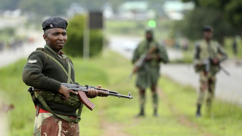 Soldiers patrol as protesters gather during a demonstration over the fuel price hikes in Zimbabwe.