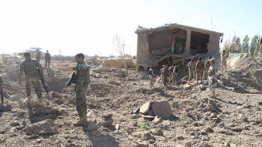 Afghan security personnel survey the site of a suicide attack at a police training centre in Gardez, the capital of Paktia province.