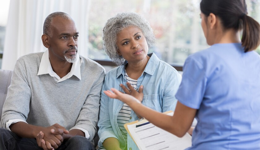Doctor discusses health concerns with senior couple