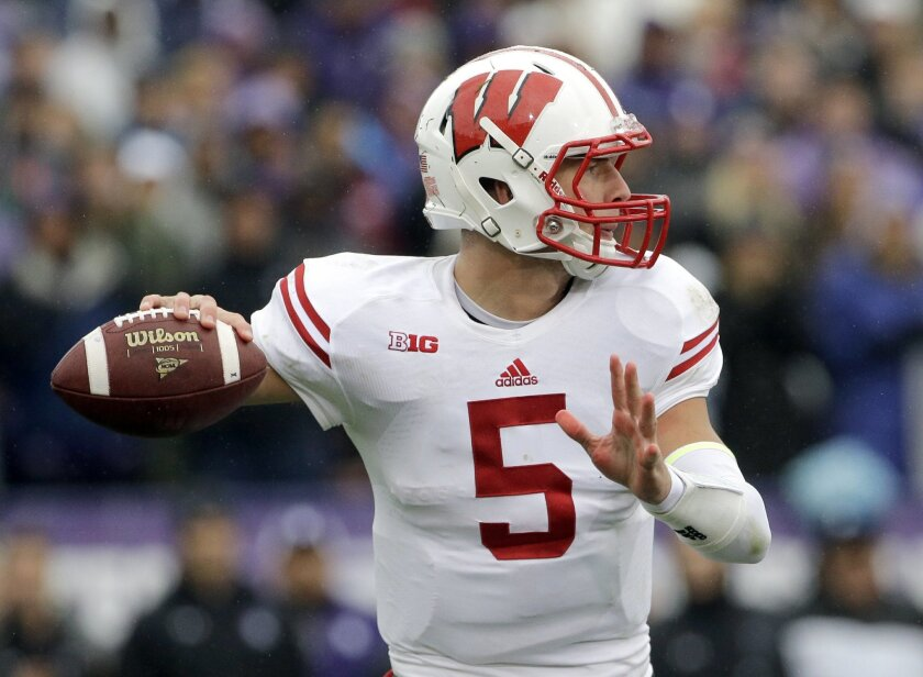 Wisconsin quarterback Tanner McEvoy (5) looks to a pass against Northwestern during the first half of an NCAA college football game in Evanston, Ill., Saturday, Oct. 4, 2014. (AP Photo/Nam Y. Huh)