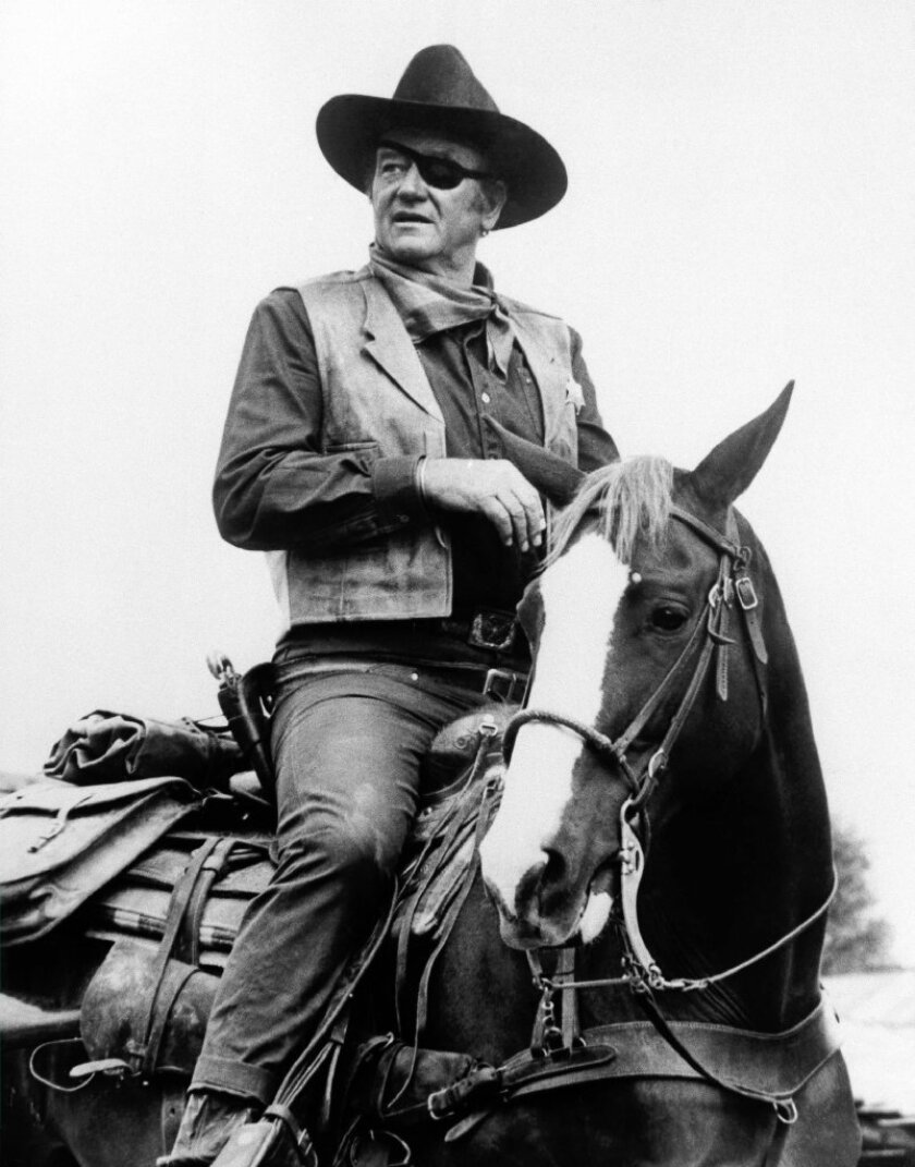 """John Wayne, in his Oscar-winning role in the 1969 film """"True Grit."""" His daughter's name is being falsely appended to an email circulating about President Obama."""