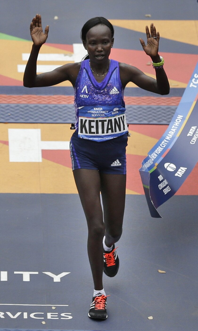 Mary Keitany, of Kenya, crosses the finish line first in the women's division at the 2015 New York City Marathon in New York, Sunday, Nov. 1, 2015. (AP Photo/Seth Wenig)