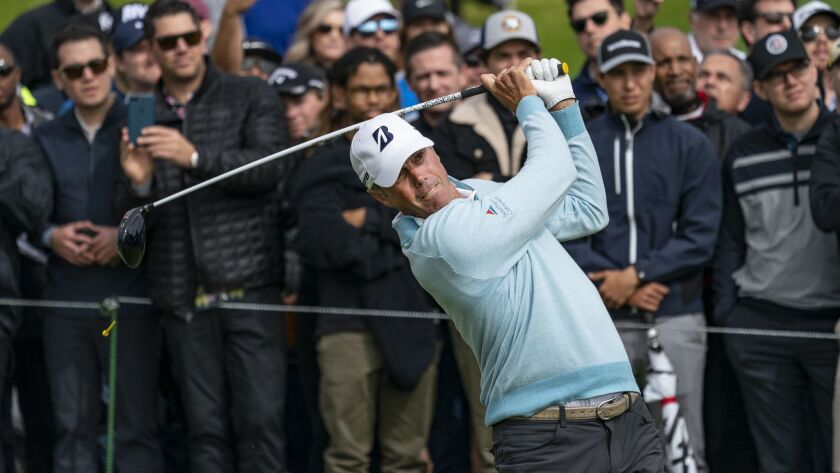 Matt Kuchar hits his tee shot on the 10th hole during his first round of the Genesis Open at Riviera Country Club.