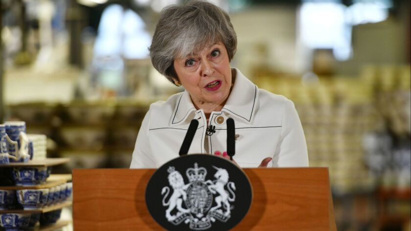 British Prime Minister Theresa May gives a speech after touring the Portmeirion pottery factory in Stoke-on-Trent, England, on Monday.
