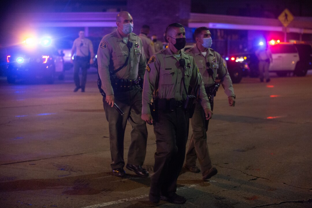 Representatives of the Los Angeles County Sheriff walked near the St. Francis Medical Center.