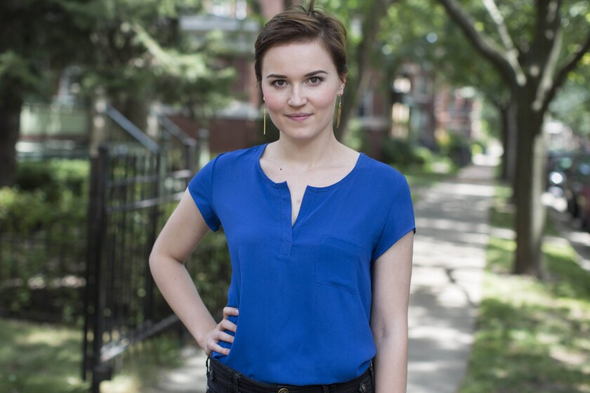"""Veronica Roth poses for a photo in Chicago, the setting for her YA dystopian """"Divergent"""" trilogy, which comes to an end with """"Allegiant."""""""