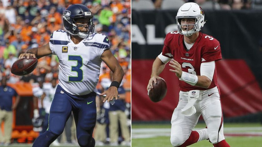 FILE - At left, in a Sept. 9, 2018, file photo, Seattle Seahawks quarterback Russell Wilson (3) roll