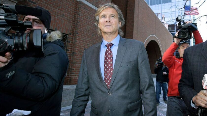 Jovan Vavic, former USC water polo coach, departs federal court in Boston on March 25.