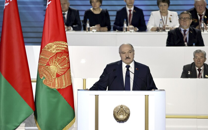"""Belarusian President Alexander Lukashenko delivers his speech to delegates of the All-Belarus People's Assembly in Minsk, Belarus, Thursday, Feb. 11, 2021. Belarus' authoritarian leader has denounced six months of protests against his rule as a foreign-directed """"rebellion"""" and vowed to resist the pressure, as he spoke at the All-Belarus People's Assembly. Lukashenko convened the gathering Thursday to discuss plans for the country's development. But the opposition has denounced it as an attempt to shore up his rule and soothe public anger with vague promises of reforms. (Sergei Sheleg/BelTA Pool Photo via AP)"""