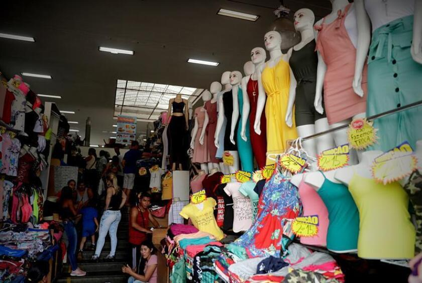 People shop at a clothing store in downtown Sao Paulo, Brazil. EPA-EFE/File