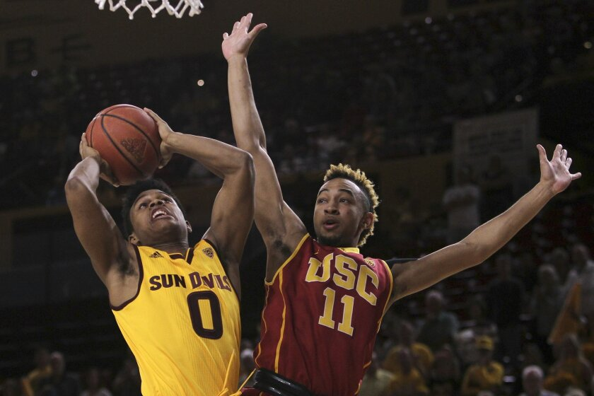 Arizona State guard Tra Holder (0) goes to the basket against Southern California guard Jordan McLaughlin during the first half of an NCAA college basketball game in Tempe, Ariz., Friday, Feb. 12, 2016. (AP Photo/Ricardo Arduengo)