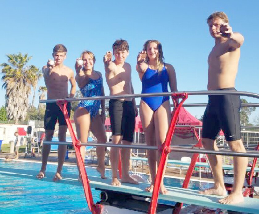 Bulldog divers holding the medals they won at the Valley League Diving Championship meet in Fallbrook are, from left, Jacob Nelson, Alexis Sampson, Matthew Thomas, Gracey Michaelis and Caden Clark.