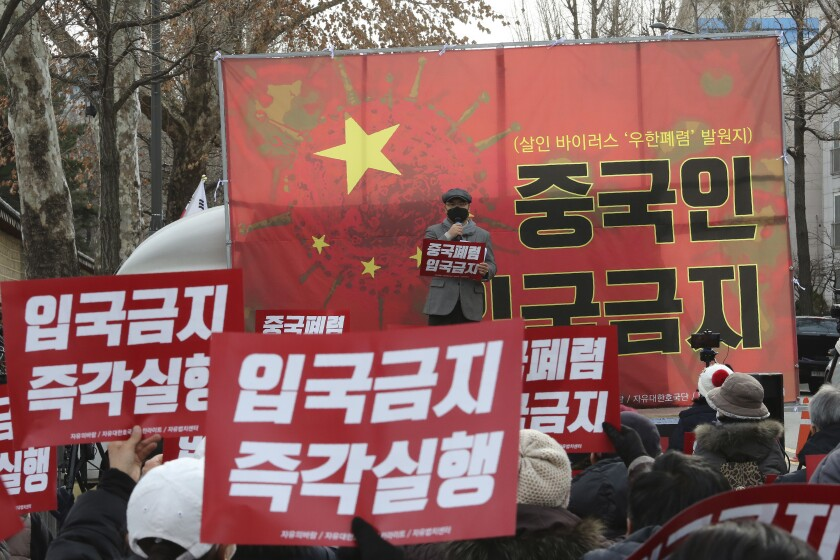 """In this Wednesday, Jan. 29, 2020, photo, South Korean protesters stage a rally calling for a ban on Chinese people entering South Korea near the presidential Blue House in Seoul, South Korea. A scary new virus from China has spread around the world. So has rising anti-Chinese sentiment, calls for a full travel ban on Chinese visitors and indignities for Chinese and other Asians. The signs read: """"No Entry."""" (AP Photo/Ahn Young-joon)"""