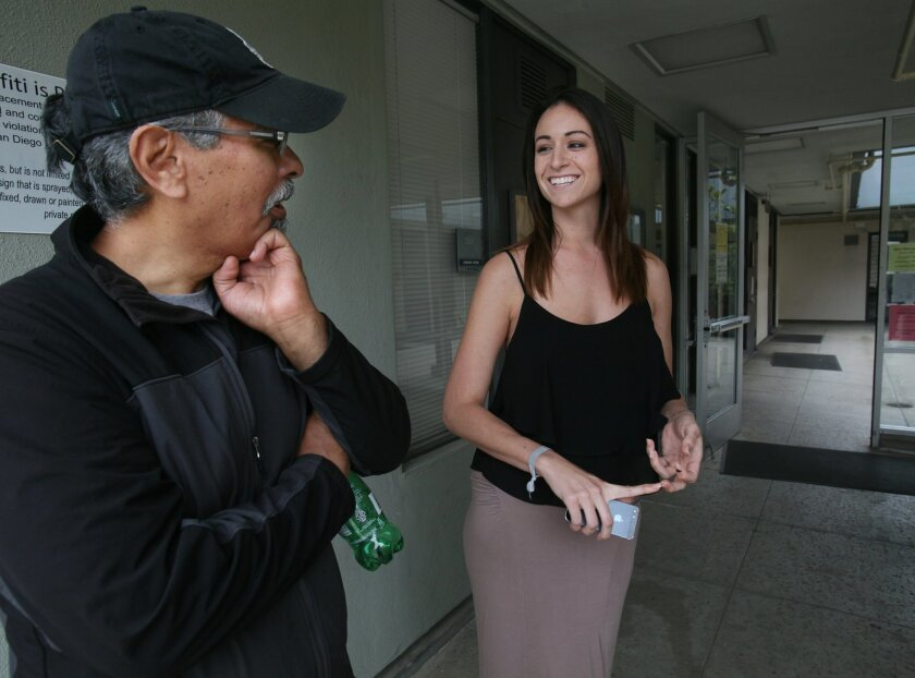 UCSD art professor Ricardo Dominguez, shown with student Lily Patterson, received international attention this week following a claim he made students perform in the nude or fail.