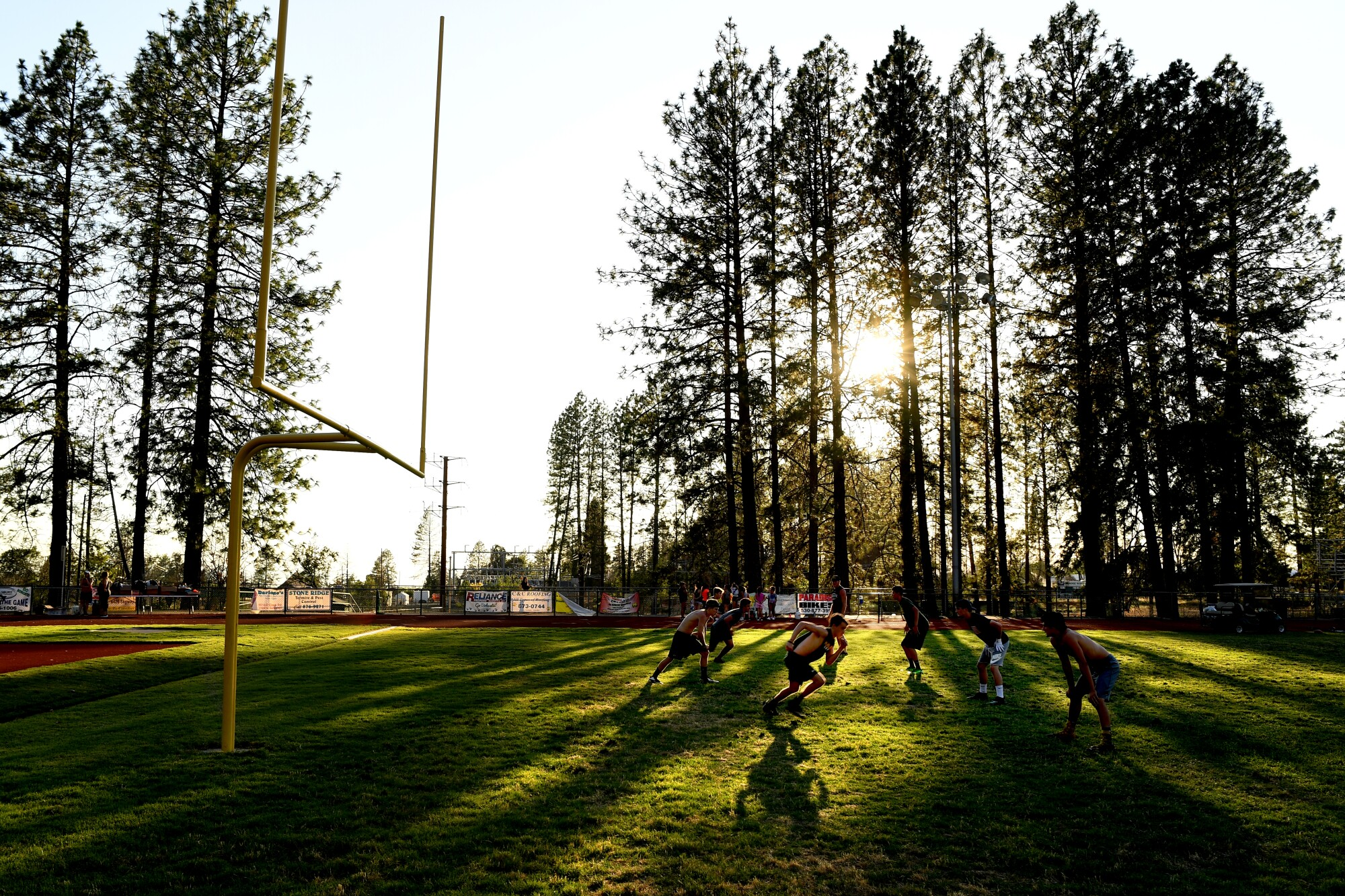 Paradise High football players practice in the late afternoon in preparation for the upcoming season.