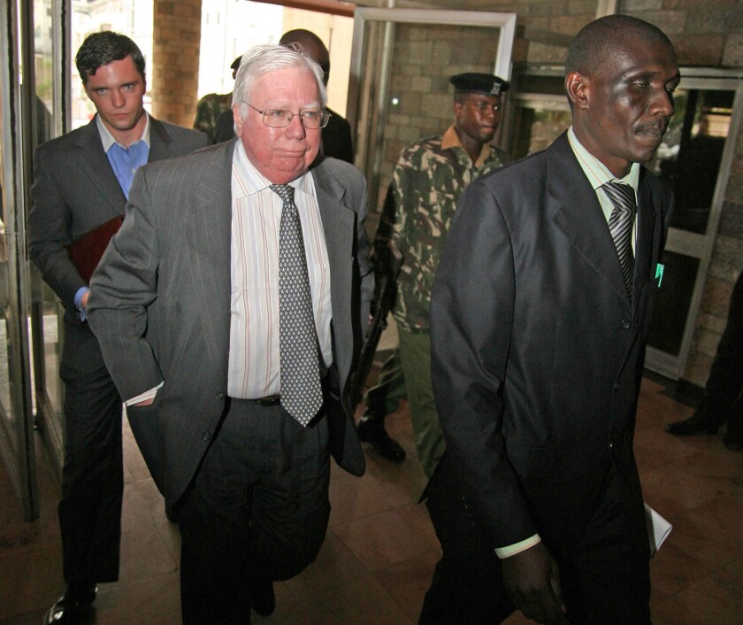 Jerome Corsi follows a Kenyan immigration officer in 2008 after he was arrested on charges of failing to obtain a work permit. He was in the African country to promote one of his fact-challenged books about Barack Obama.