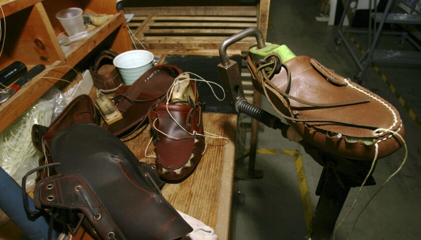 This Aug. 11, 2010, file photo, shows shoes at the research and development room of Timberland Company in Stratham, N.H. VF Corp. says it plans to split into two publicly traded companies, with one focusing on clothing and footwear and the other concentrating on jeans.
