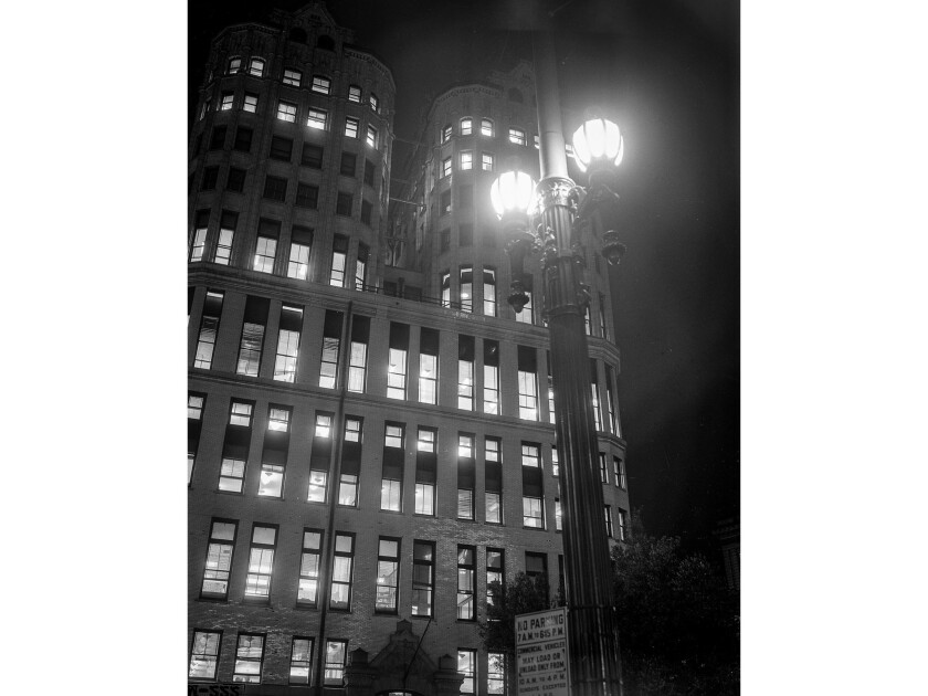 December 1955: Nighttime image of Los Angeles old Hall of Records from Spring Street side.
