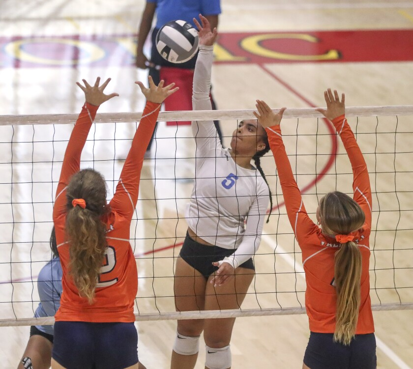 Maranatha Christian's Amy Buffini tries to hit the ball past Valhalla's Aubrey Woods (right) and Julia Thomas during the San Diego Section Division II final.