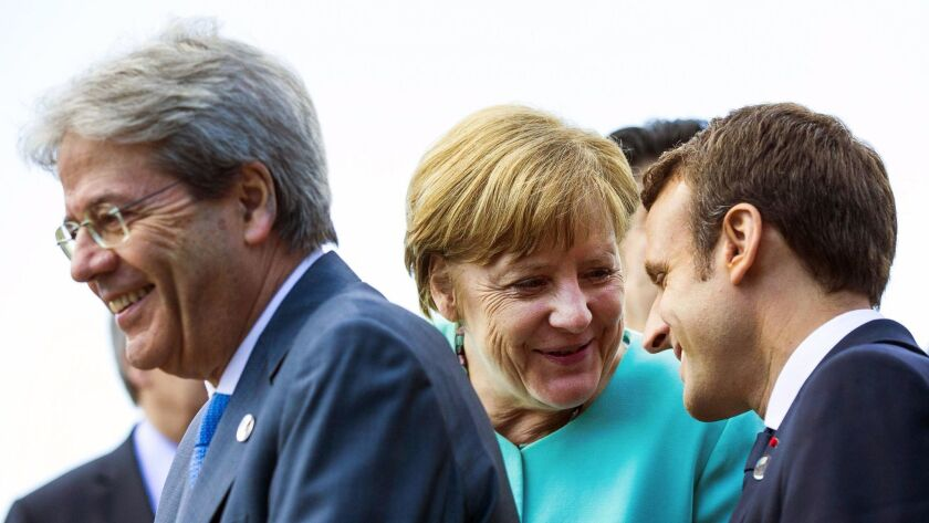 Italian Prime Minister Paolo Gentiloni, left, German Chancellor Angela Merkel and French President E