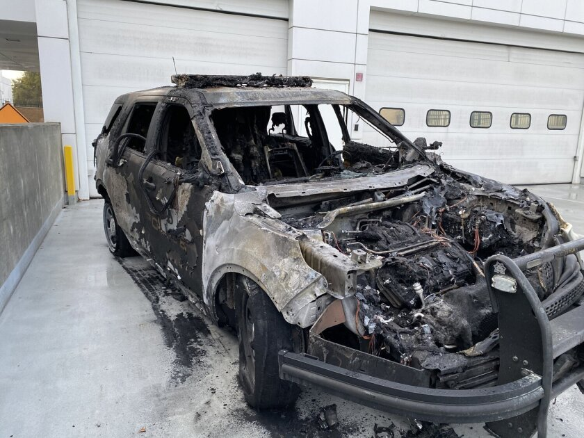 A man was arrested after authorities said he set an unoccupied police vehicle on fire outside the Hawthorne station.
