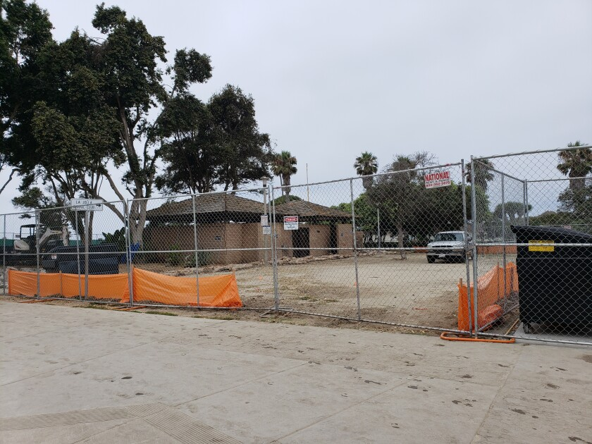 Fencing has gone up in preparation for the demolition and construction of the Scripps Park restroom facility, adjacent the La Jolla Cove.