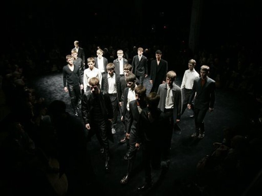 Model wear creations of Prada men's Fall-Winter 2009/2010 collection, part of the Milan Fashion Week, unveiled in Milan, Italy, Sunday, Jan 18, 2009. (AP Photo/Antonio Calanni)