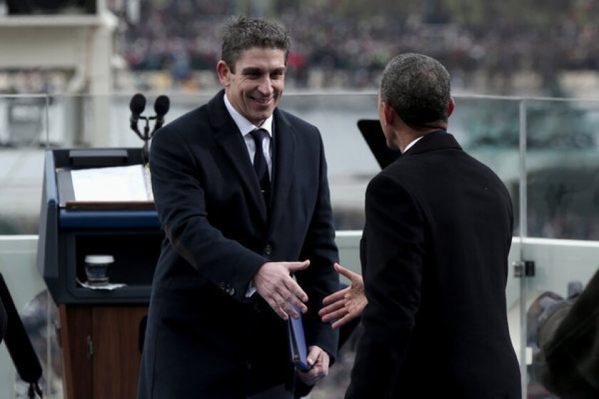 Richard Blanco is greeted by President Obama during the 57th presidential inauguration.