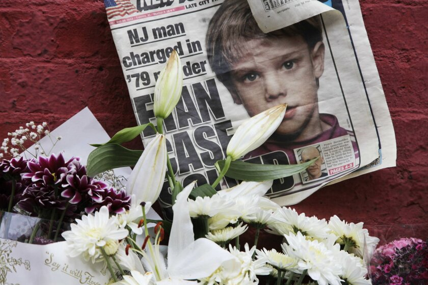 FILE - This May 28, 2012, file photo shows a newspaper with a photograph of Etan Patz that is part of a makeshift memorial in the SoHo neighborhood of New York. Jury selection is set to start Monday, Jan. 5, 2015, in Hernandez's murder trial. As the murder case surrounding Patz' notorious 1979 disa