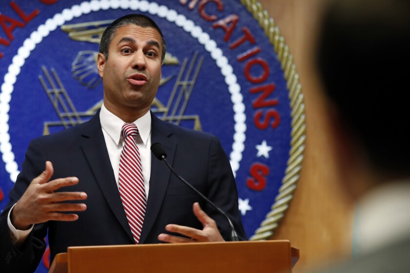 After a meeting voting to end net neutrality, Federal Communications Commission (FCC) Chairman Ajit Pai answers a question from a reporter, Thursday, Dec. 14, 2017, in Washington. On Thursday Pai and the FCC proposed a nearly $10 million find for a San Diego-based telemarketer.