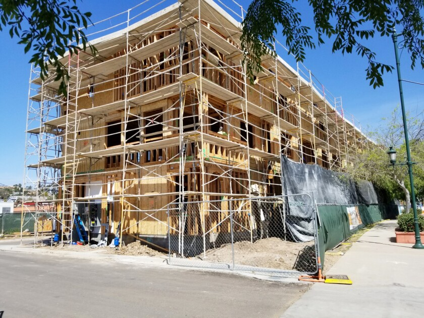 The first seven Metis-style townhomes, now under construction on the corner of Poway Road and Civic Center Drive.