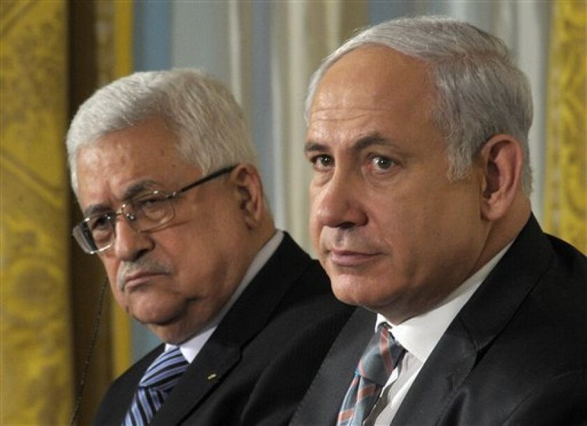 Palestinian President Mahmoud Abbas, left, and Israel's Prime Minister Benjamin Netanyahu, listen during remarks in the East Room of the White House in Washington, Wednesday, Sept. 1, 2010. (AP Photo/Susan Walsh)
