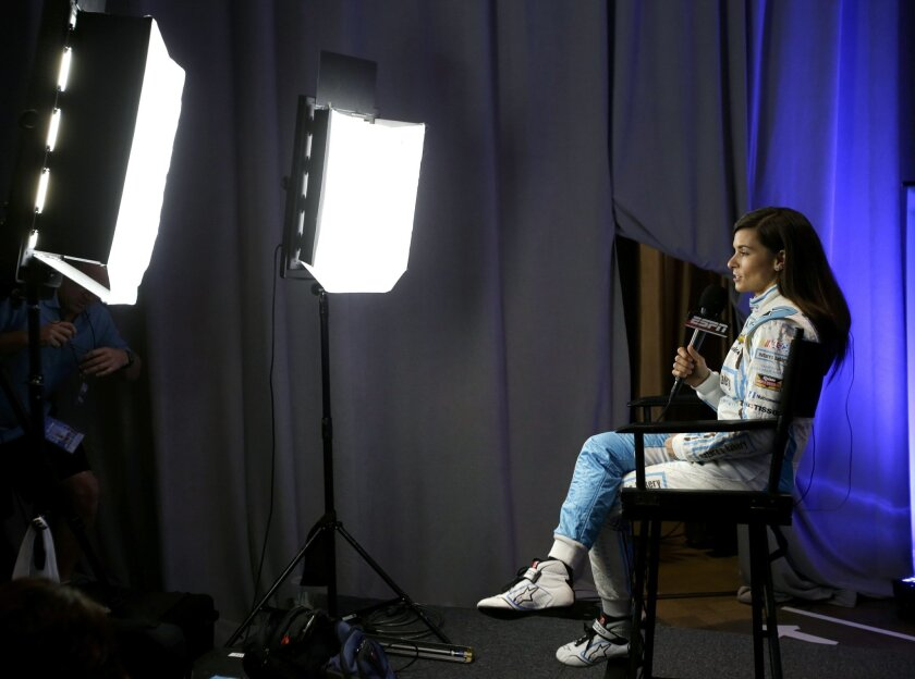 Danica Patrick answers questions during an interview at NASCAR media day at Daytona International Speedway, Tuesday, Feb. 16, 2016, in Daytona Beach, Fla. (AP Photo/John Raoux)