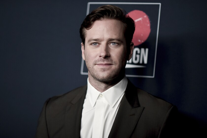 Armie Hammer in a suit with no tie