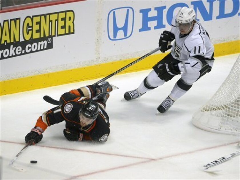 Anaheim Ducks right wing Kyle Palmieri, left, dives for the puck as Los Angeles Kings center Anze Kopitar, of Slovenia, gives chase during the second period of their NHL hockey game, Saturday, Feb. 2, 2013, in Anaheim, Calif. (AP Photo/Mark J. Terrill)
