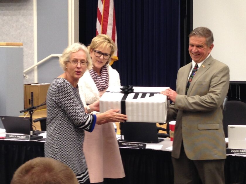 Outgoing board member Doug Perkins was honored by Del Mar Heights Principal Wendy Wardlow and Superintendent Holly McClurg.