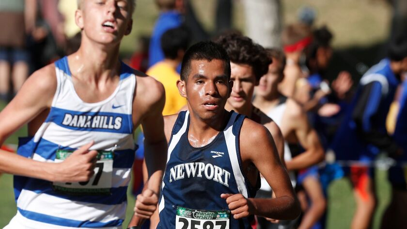 Newport's Alexis Garcia eyes the last leg of the Boys Sweepstakes race in the Orange County Cross Co